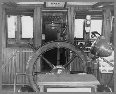 Wheelhouse view showing wheel and radio in background
