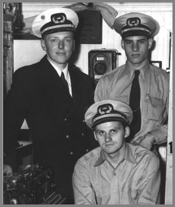 Three radio operators in uniform in the Radio Room of the SS South American
