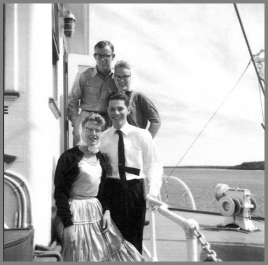 Photo of Tom Drake and Ray Heimberger with two young lady passengers on the SS South American