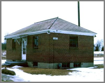 Photo of the exterior of WAD's brick station building