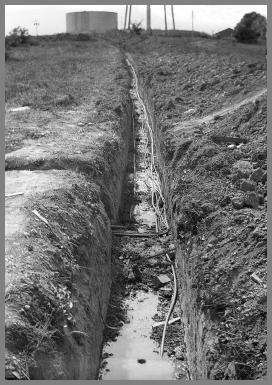 View of the power and comm. lines trench.