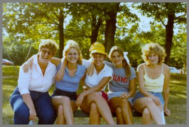 Five WCM operators at a summer picnic